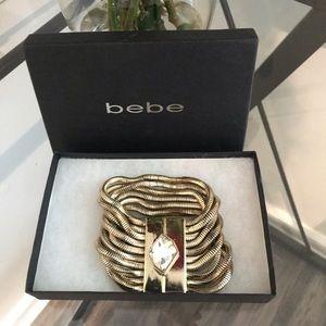 Bebe gold and rhinestone magnetic bracelet